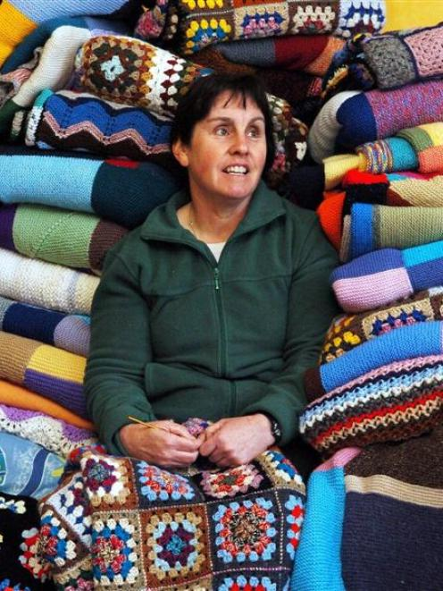 Operation Cover Up Dunedin co-ordinator Shona Bovey sits among some of the donated items for this...
