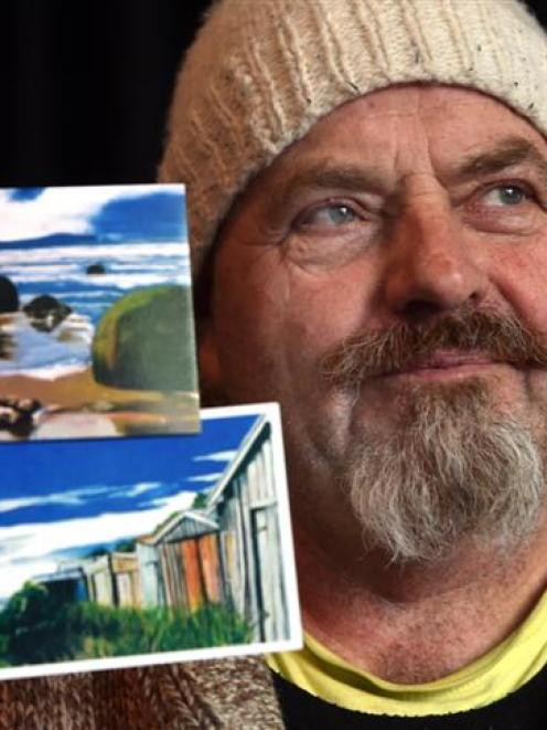 Orion Das with prints of two of the paintings that were in his van when it was stolen from St...