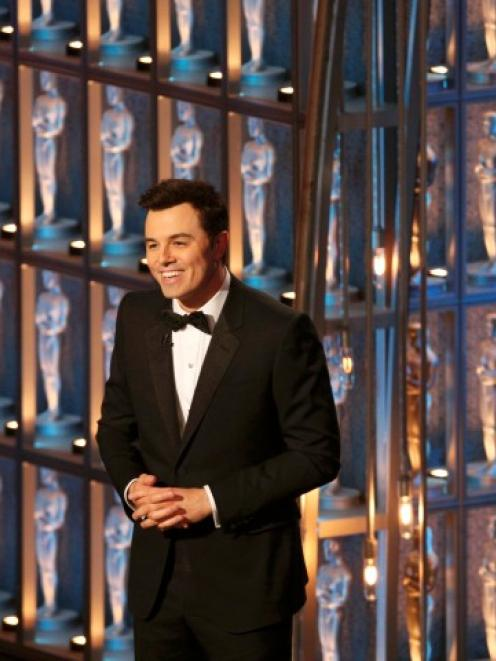 Oscar host Seth MacFarlane speaks on stage at the 85th Academy Awards in Hollywood, California....
