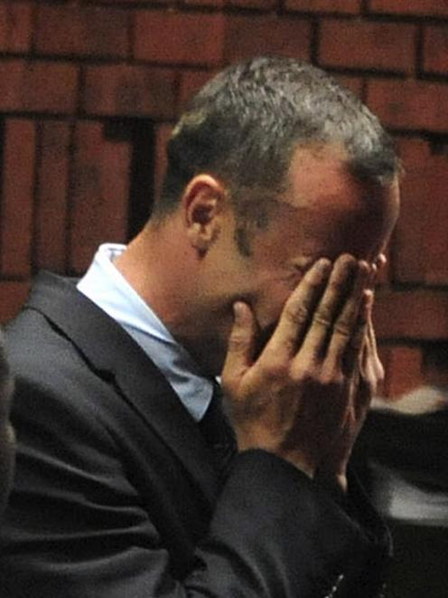 Oscar Pistorius breaks down during his court appearance in Pretoria. REUTERS/Antonie de Ras