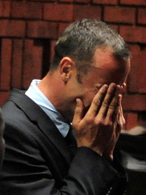 Oscar Pistorius breaks down during his court appearance in Pretoria. REUTERS/Antonie de Ras