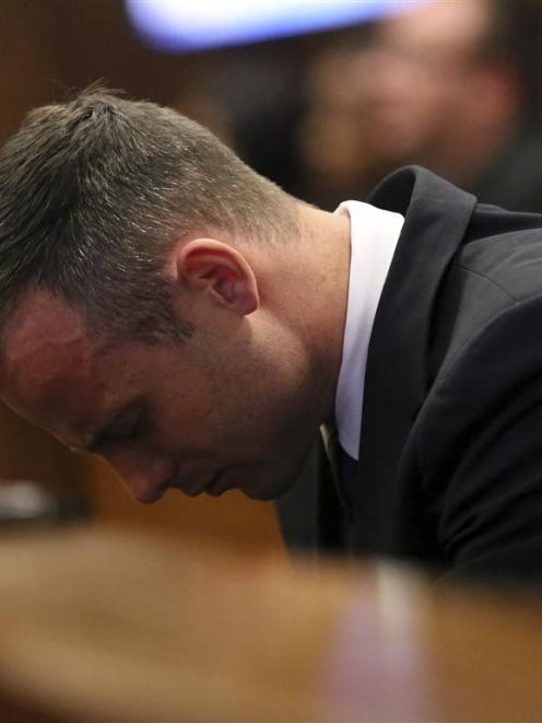 Oscar Pistorius heard a stark summary of how he shot his girlfriend.  REUTERS/Siphiwe Sibeko