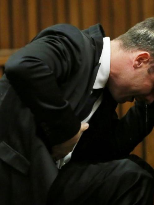 Oscar Pistorius is overcome by emotion during his trial at the high court in Pretoria. REUTERS...