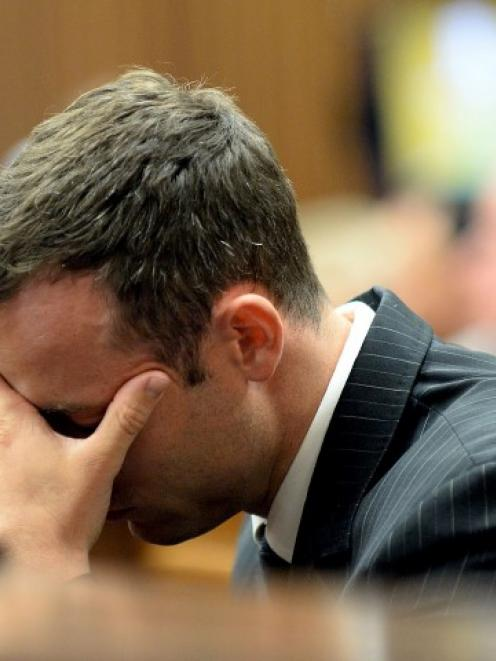 Oscar Pistorius reacts as he hears a testimony at the North Gauteng High Court in Pretoria....