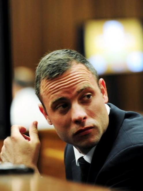 Oscar Pistorius sits in the dock during court proceedings at the North Gauteng High Court in...