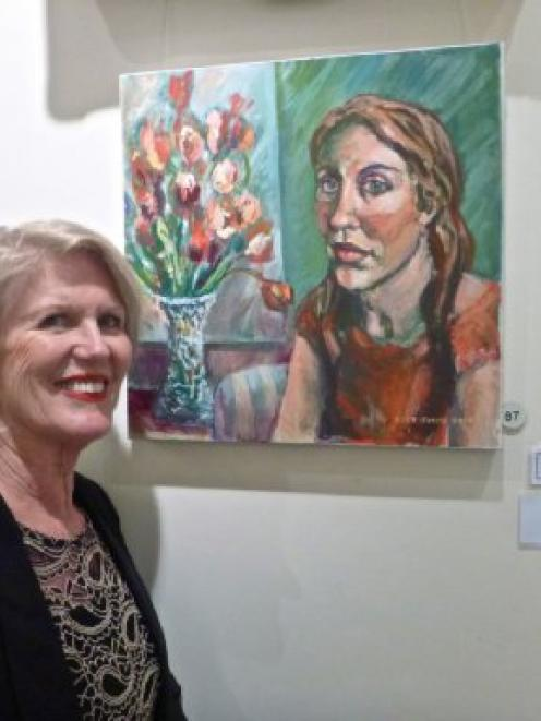 Otago Art Society 2014 exhibition winner Judy Smith, with her acrylic painting Emma. Photo supplied.