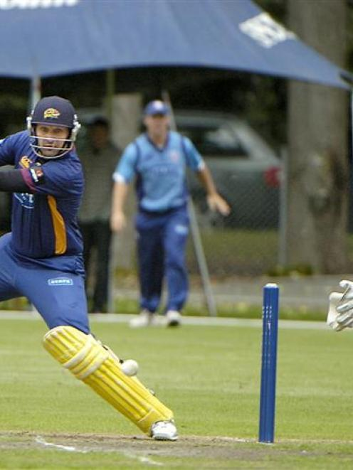 Otago batsman Greg Todd cuts the ball towards point in his side's twenty/20 game against Auckland...