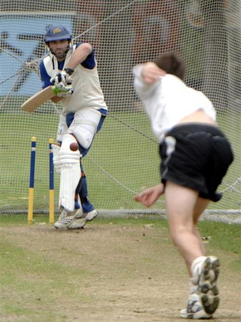Otago batsman Leighton Morgan defends a delivery from James Fuller during a training session at...