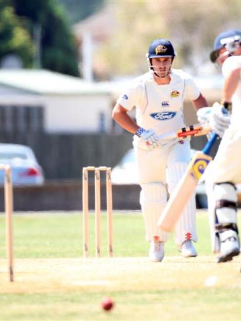 Otago batsmen  Aaron Redmond and Hamish Rutherford run  off a hit by Redmond against  Central...