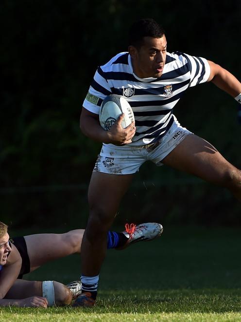 Otago Boys' High School centre Hemaua Samasoni breaks the tackle of Christchurch Boys' High...