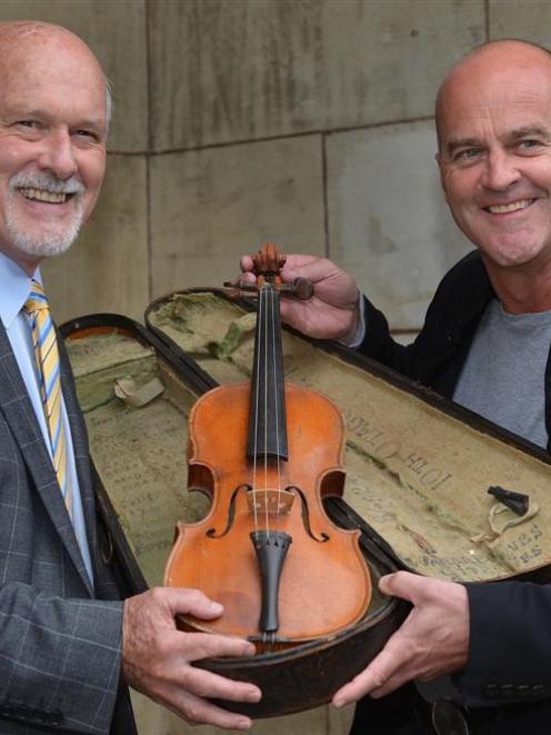 Otago Boys' High School rector Clive Rennie (left) and TV producer Matthew Thomason hold the...
