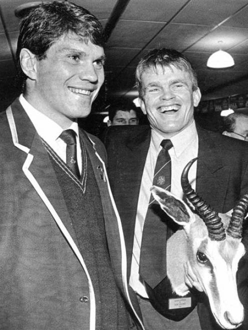 Otago captain David Latta (right) accepts the springbok head from South Africa captain Tiaan...
