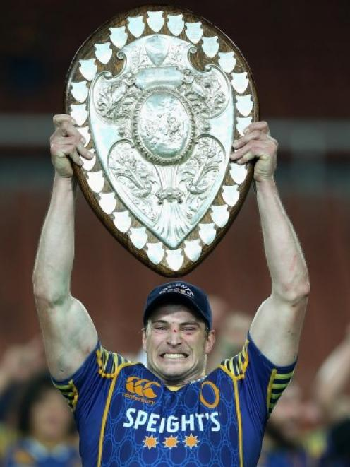 Otago captain Paul Grant holds the Ranfurly Shield aloft after his team beat Waikato in Hamilton...