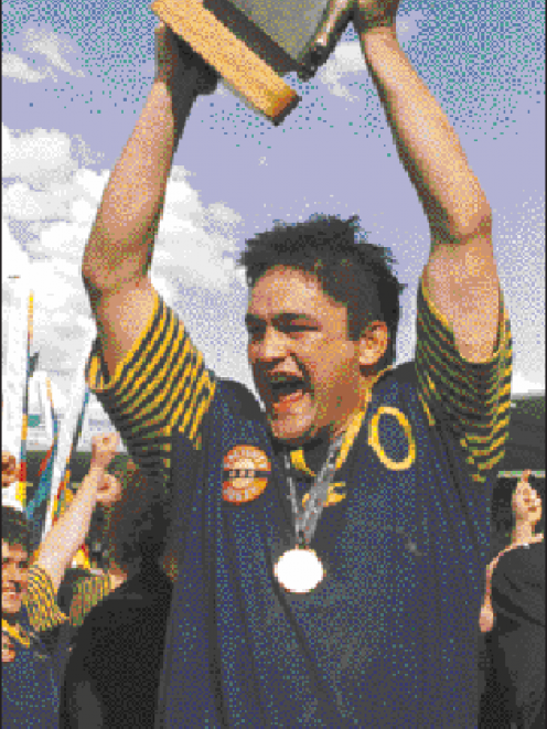 Otago captain Taine Randall holds aloft the National Provincial Championship trophy after his...