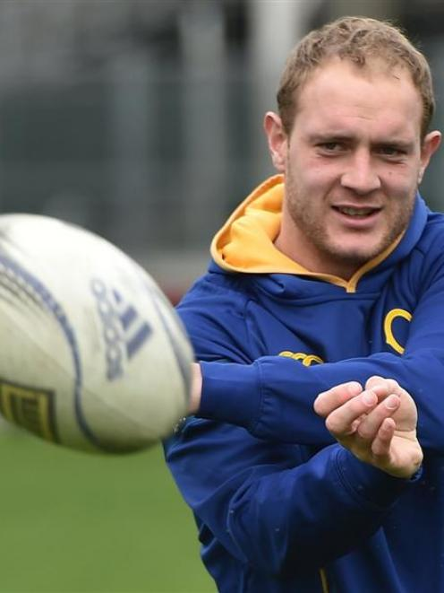 Otago centre Matt Faddes fires off a pass during team training on Tuesday. Photo by Gregor...