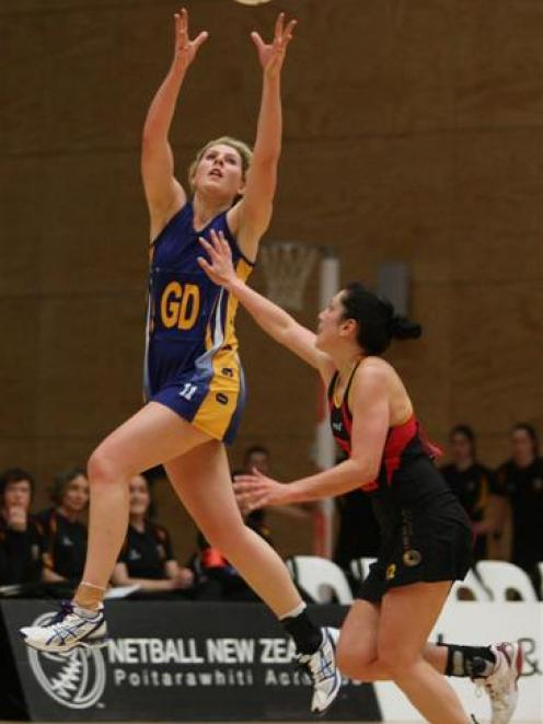 Otago defender Storm Purvis reaches for a pass during the national provincial netball final...