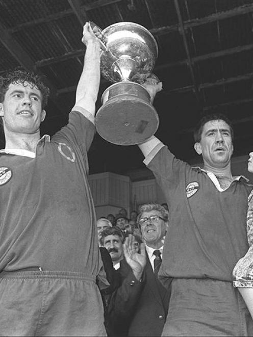 Otago forwards Mike Brewer (left) and Richard Knight celebrate with the trophy after sealing...