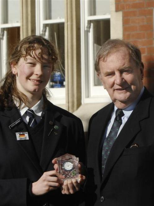 Otago Girls High School pupil Anna Scadden with the Waterford Crystal clock presented by honorary...