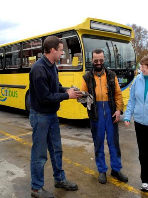 Otago Heritage Bus Society member Alastair Stewart (left), Citibus mechanic Mike Jeffery and...