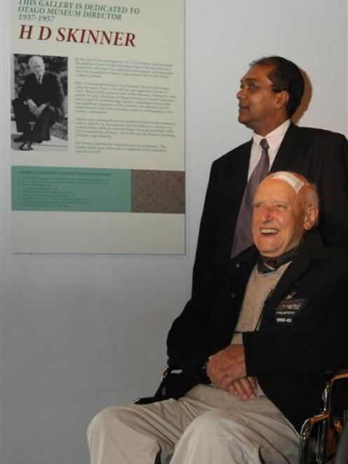 Otago Museum chief executive Shimrath Paul (rear) and Richard Skinner reflect on an information...