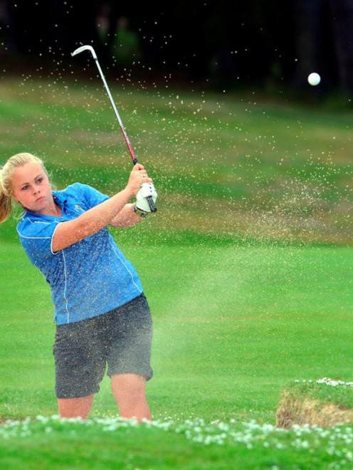 Otago No 1 Laura Hoskin plays from a greenside bunker on the 11th hole during her 4 and 3 win...