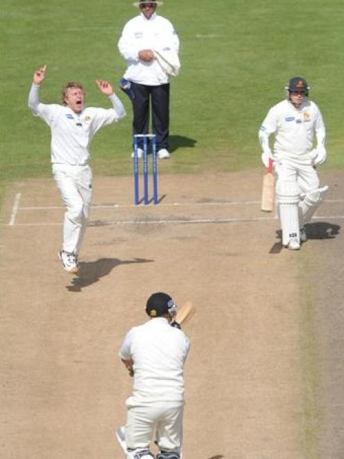 Otago opening bowler Neil Wagner (left) traps Wellington batsman Neal Parlane lbw during a drawn...