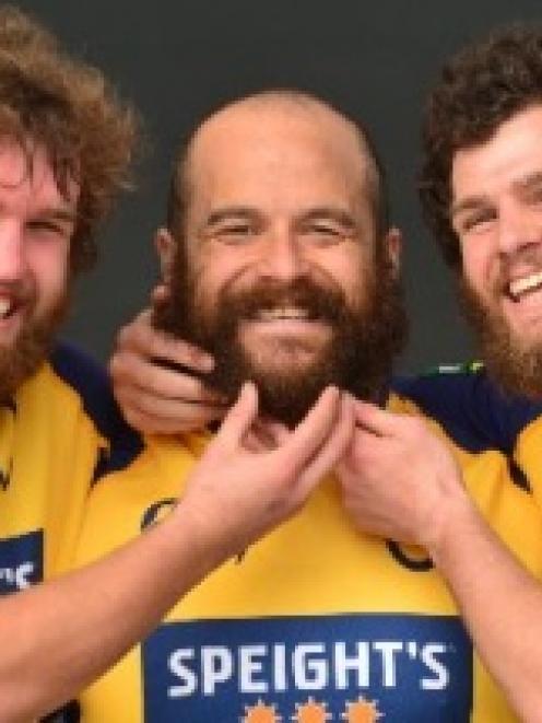 Otago players (from left) Liam Coltman, Tama Tuirirangi and Kieran Moffat embrace the  beards...