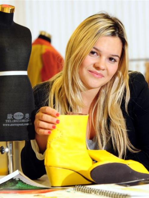 Otago Polytechnic fashion student Alina Cioaga (24) shows off one of her creations in Dunedin...