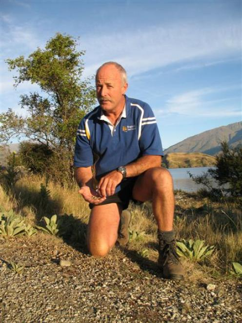 Otago Regional Council senior field adviser Peter Preston is preparing a winter rabbit poisoning...
