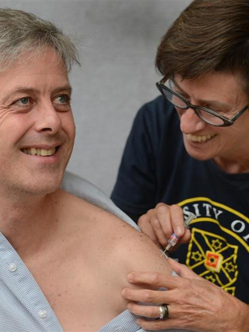 Otago research and enterprise deputy vice-chancellor Prof Richard Blaikie receives his flu...