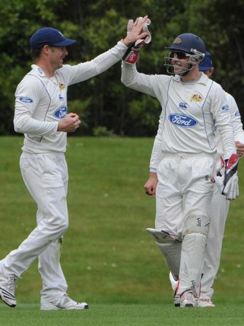 Otago's Aaron Redmond (left) and Derek de Boorder celebrate the wicket of Canterbury's Dean...