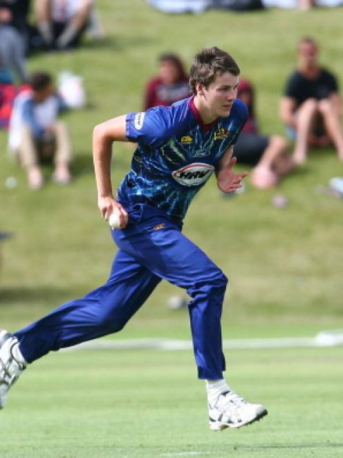Otago seamer Jacob Duffy runs in to bowl during the Twenty20 match between Otago and Auckland in...