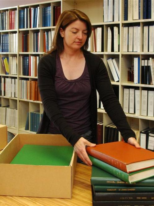 Otago Settlers Museum archivist Jill Haley yesterday boxes several volumes of information about...
