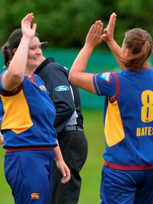 Otago Sparks all-rounder Sarah Tsukigawa (left) is congratulated by  skipper Suzie Bates after...