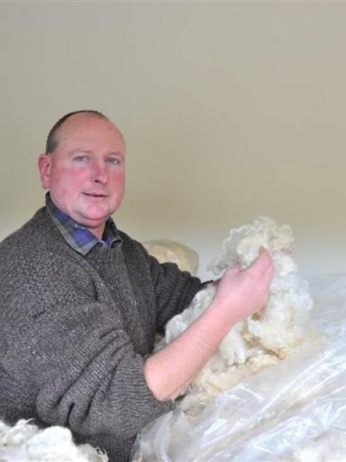 Otago-Taieri A&P Society president Wayne Smaill  with  a fleece entered in this week's  Mosgiel...