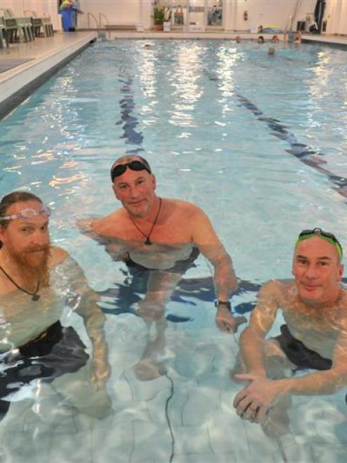 Otago Therapeutic Pool regulars (from left) Mark Baxter and twins Stephen and Allan Facer chat...