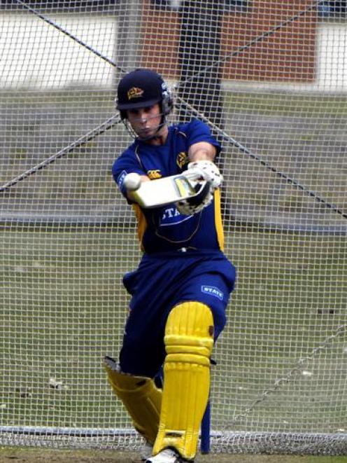 Otago top order batsman Shaun Haig gets in some slogging practice ahead of the twenty/20 match to...