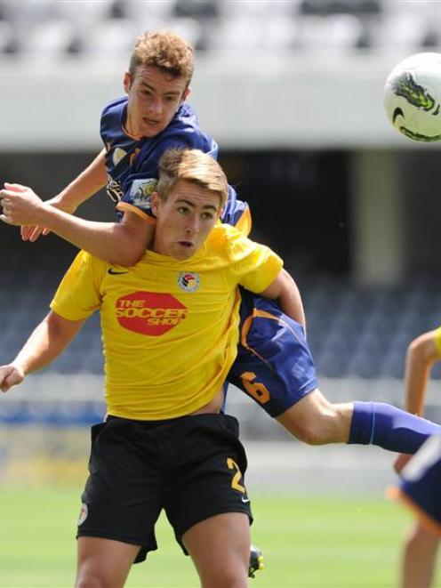 Otago United player Morgan Day (top) and Waikato's Tyler Boyd compete during their ASB...