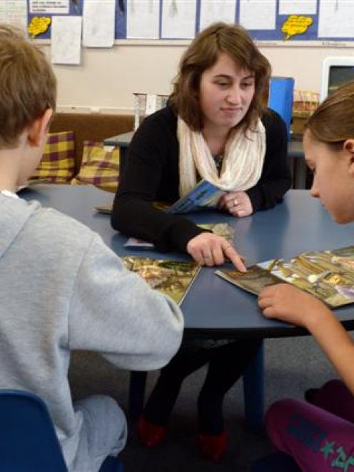 Otago University College of Education student Sacha Hatton (21) takes a reading lesson at George...