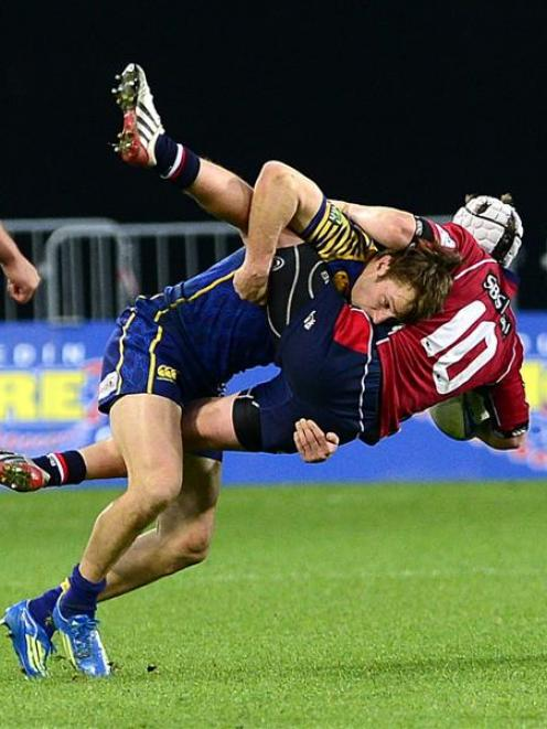 Otago wing Marshall Suckling slams into Tasman first five-eighth Hayden Cripps during their ITM...