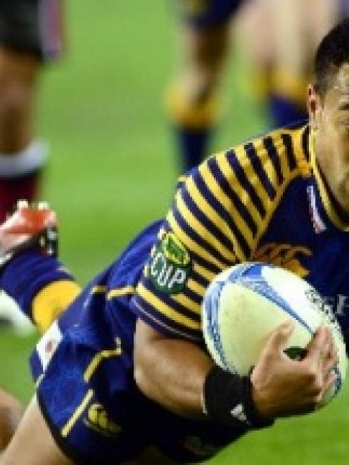 Otago winger  Buxton Popoali'i scores a try against North Harbour in their ITM Cup clash at...