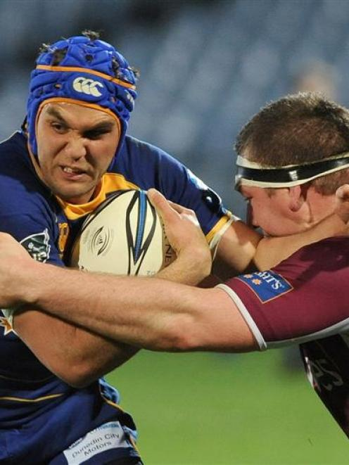 Otago winger Ryan Shortland tries to fend off of Southland prop Chris King during the teams' Air...