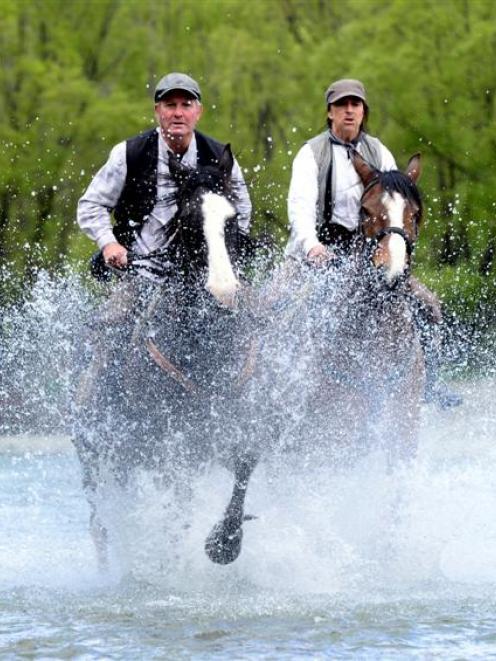 Otatara riders Brent Pierce (left) on Blackjack and his wife Suzi on Paikea familiarise...