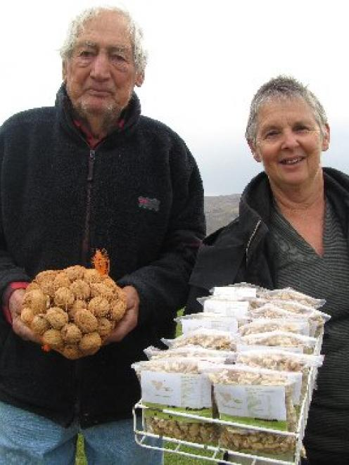 Otto and Valda Muller with the end product - walnuts ready for sale.  Photo by Sarah Marquet.