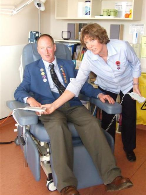 Owaka Lions Club member Alan Bichan is shown by district nurse Lynn Dawson how to operate one of...