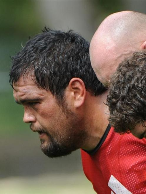 Packing down at scrum practice is David Te Moana (left) alongside Jason Rutledge (centre) and...