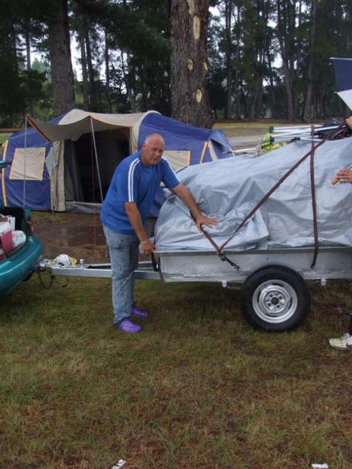 Packing up their tent site at the Albert Town Camping Ground yesterday are (from left) James...