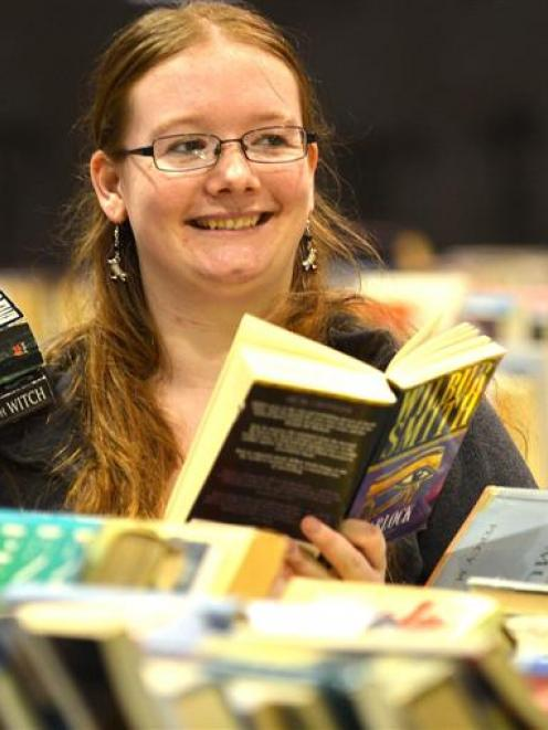 Paige Samson checks her last-minute bargains  at the end of  the Regent 24-hour Book Sale on...