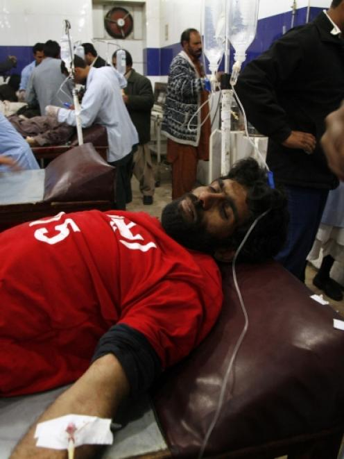 An injured rescue worker receives treatment in a hospital after the second bomb blast in Quetta....