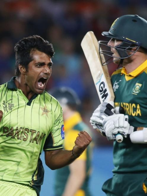 Pakistan's Rahat Ali celebrates dismissing South Africa's Kyle Abbott (R) during their Cricket...